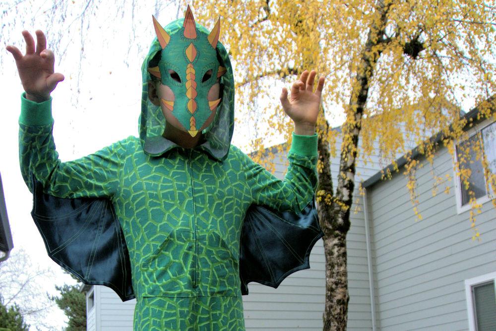 Green dragon wings in hooded pajamas