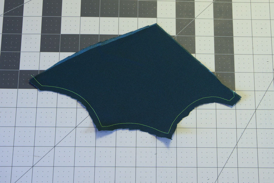 Hemmed set of green wings