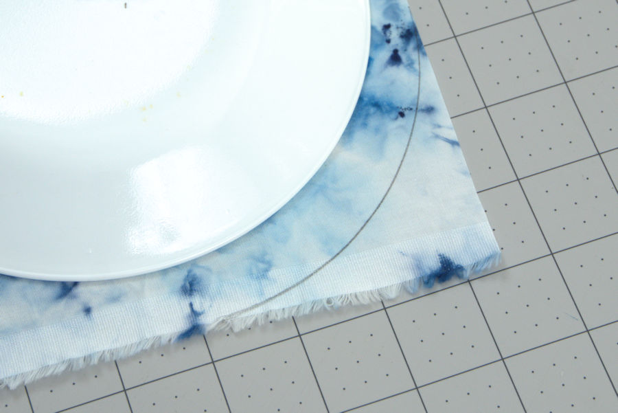 Plate used as template for rounding blanket corners