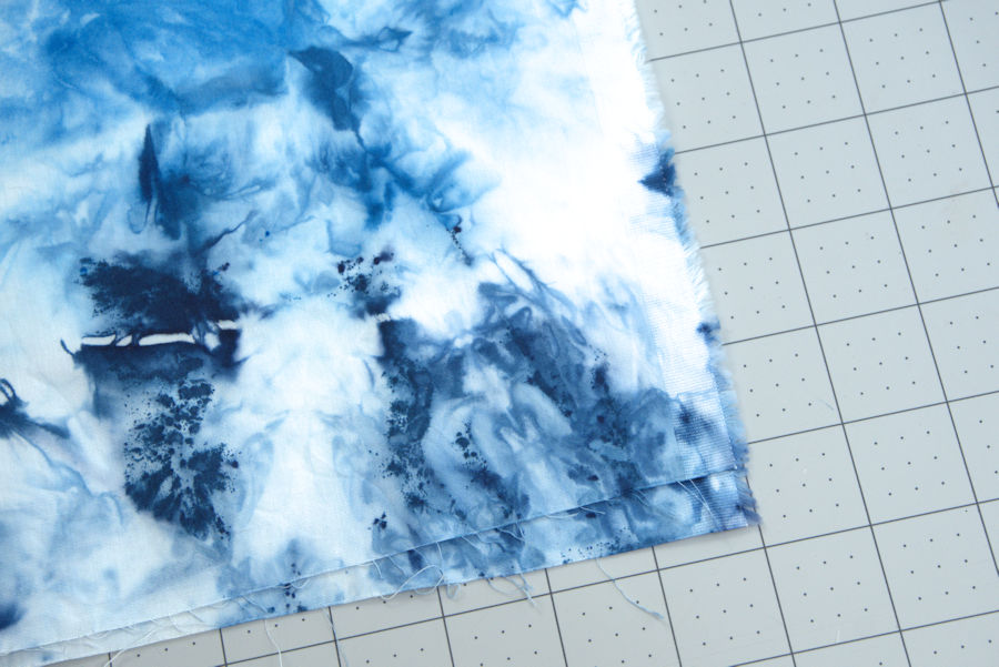 Uneven edges of blue dyed fabric