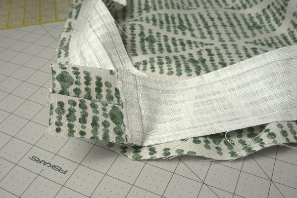 Sewing edges of chair cushion to zipper