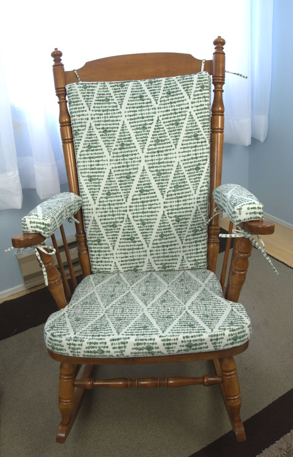 Green rocking chair with cushions