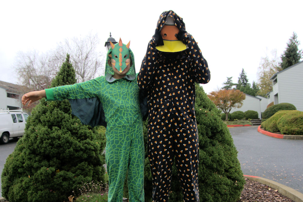 Dragon and candy corn hooded onesies