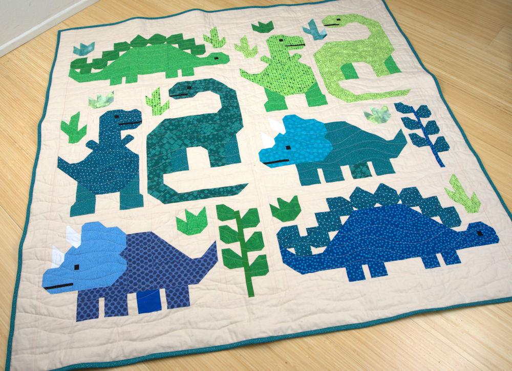 Elizabeth Hartman Dinosaur Sampler in greens and blues