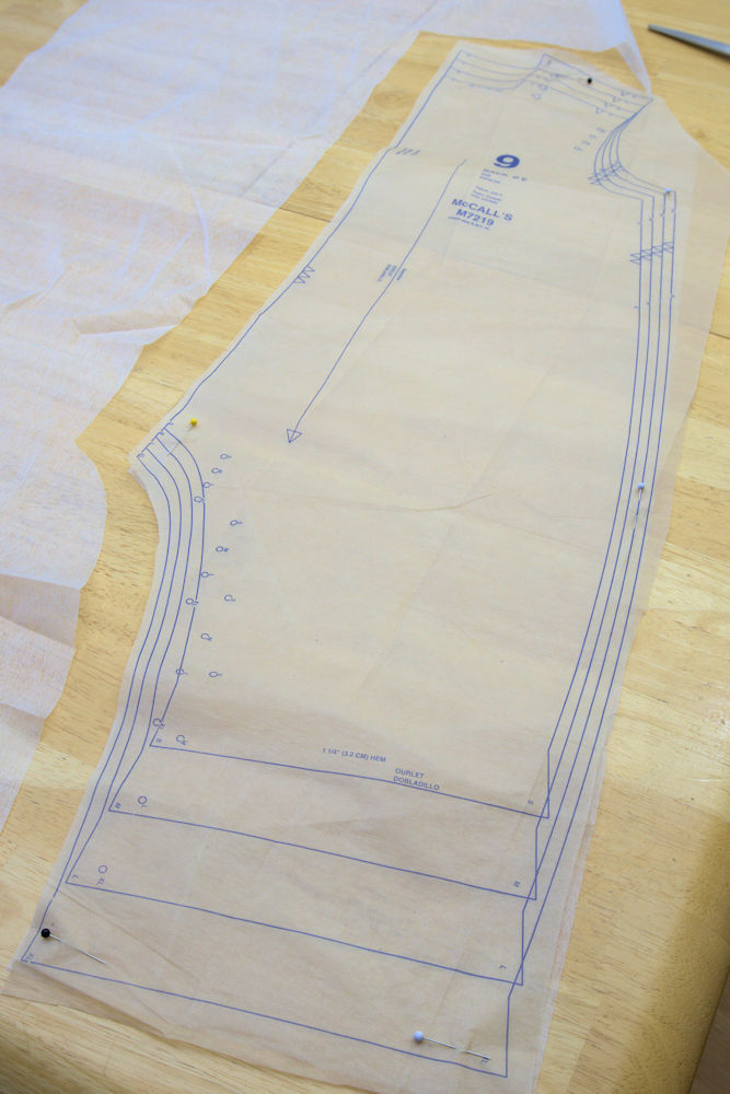 Tissue paper pattern pinned to interfacing