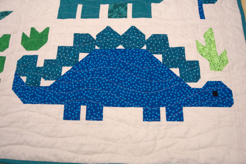 Stegosaurus quilt block in blue and green