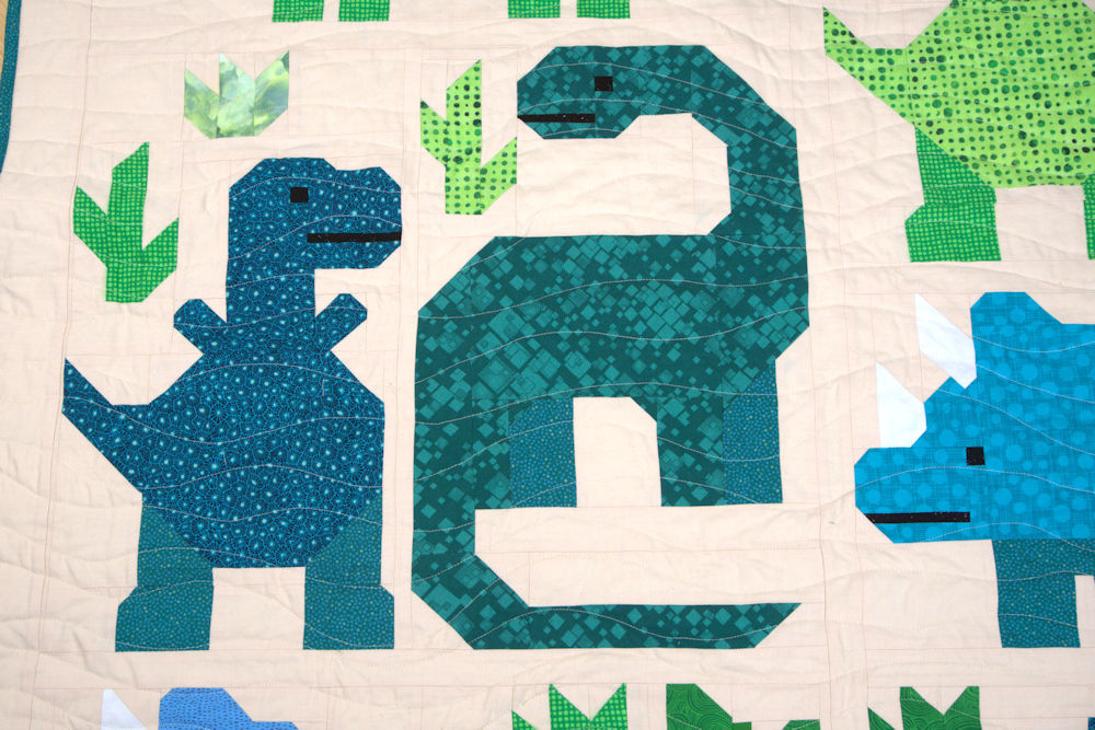 T-Rex and dino friends in blue-greens