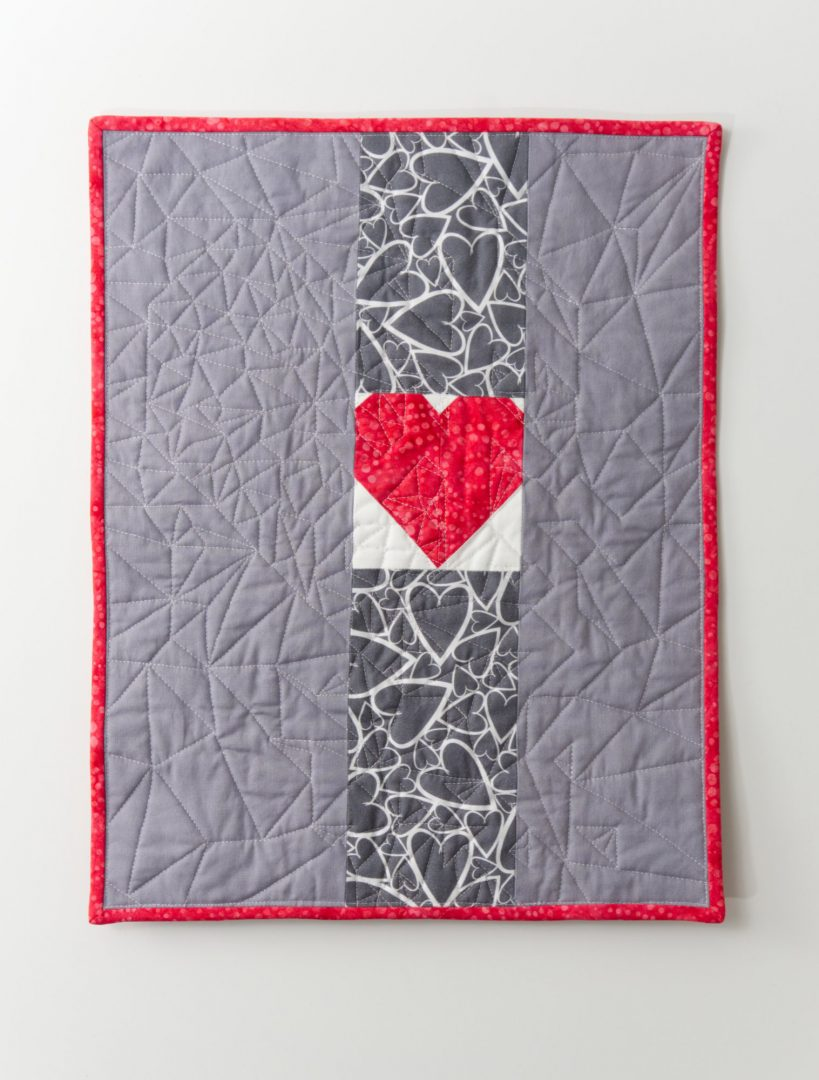 Heart strip on back of quilt