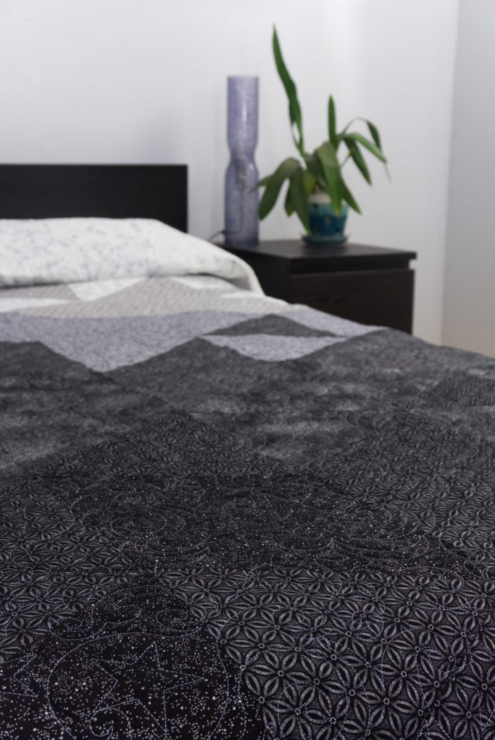 Black and white gradient quilt on bed