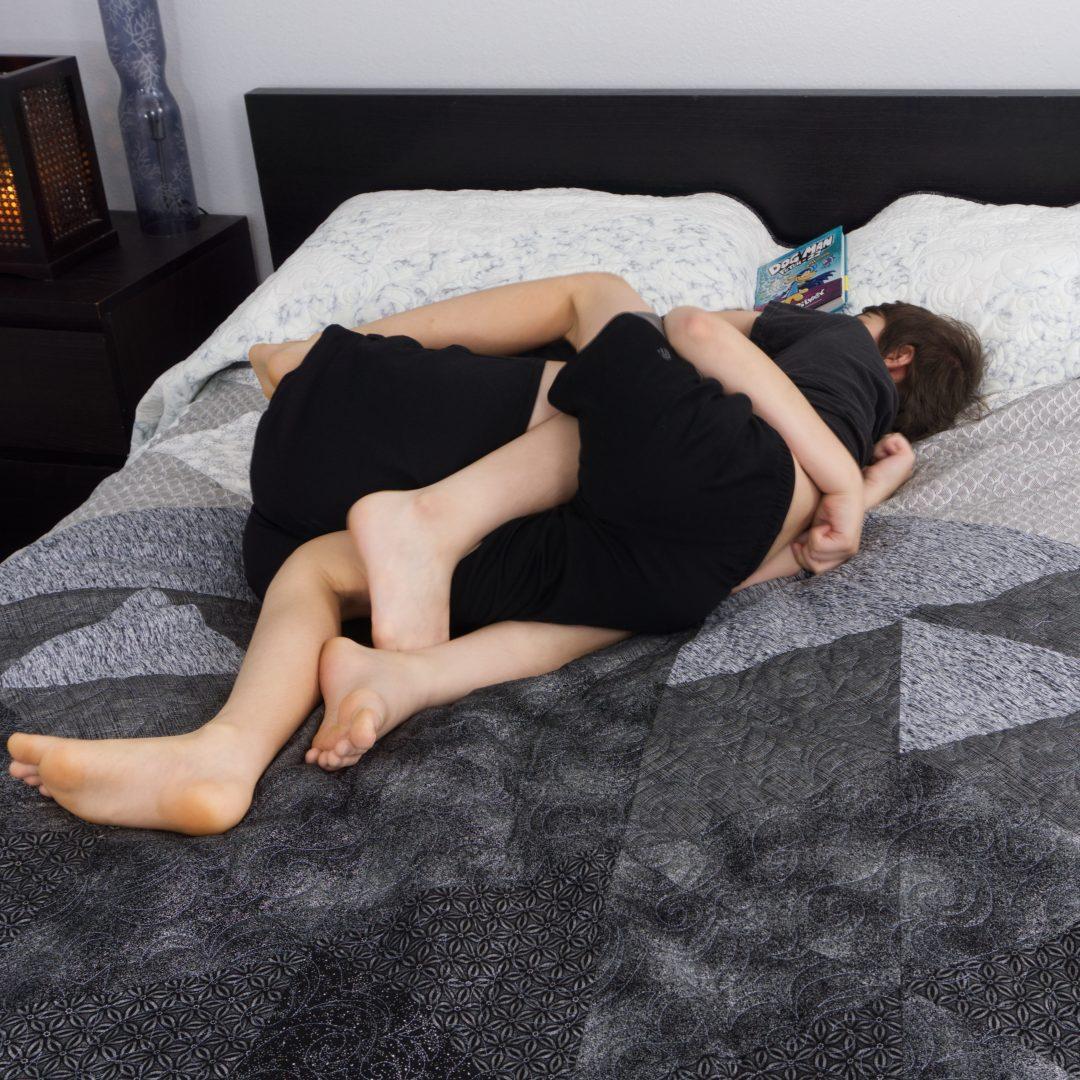 Kids wresting on bed