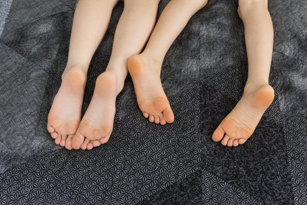 Kids feet on quilt