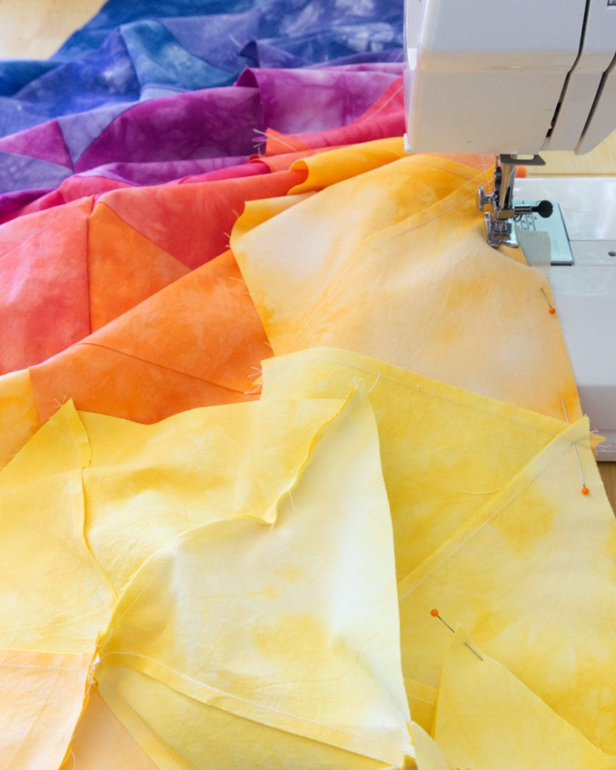 Sewing sunset quilt on machine