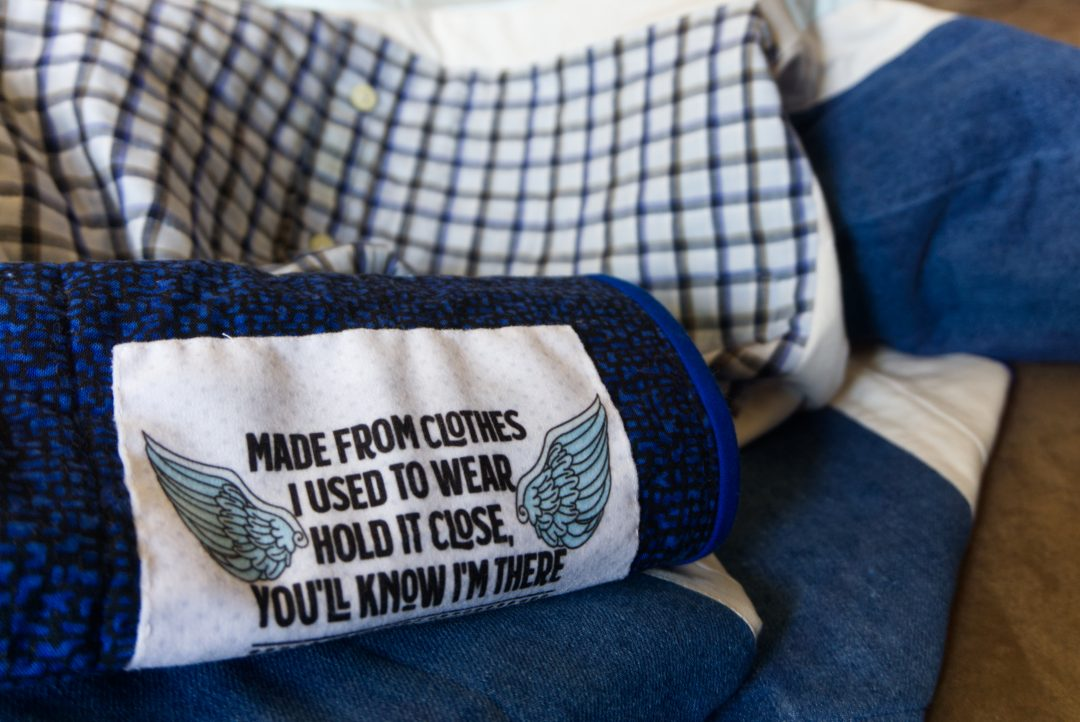 """Memory quilt label reading """"Made from clothes I used to wear. Hold it close, you'll know I'm there."""""""
